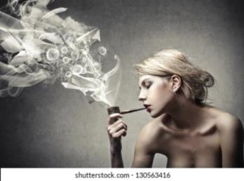 beautiful-woman-smokes-pipe-260nw-130563416